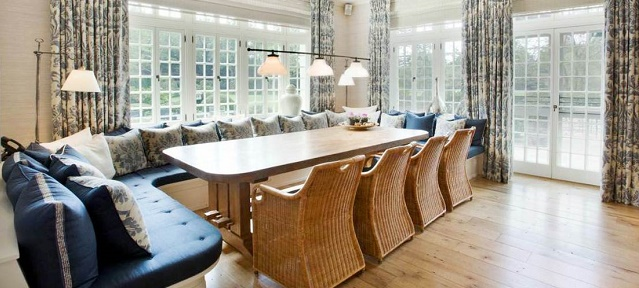 """Decorating rules you have to break"" house beautiful House Beautiful tips: decoratating rules you have to break ozy hamptons mansion estate home breakfast area informal dining room banquette seating wicker chairs bench seating blue seat cushion brocade drapes drapery1"