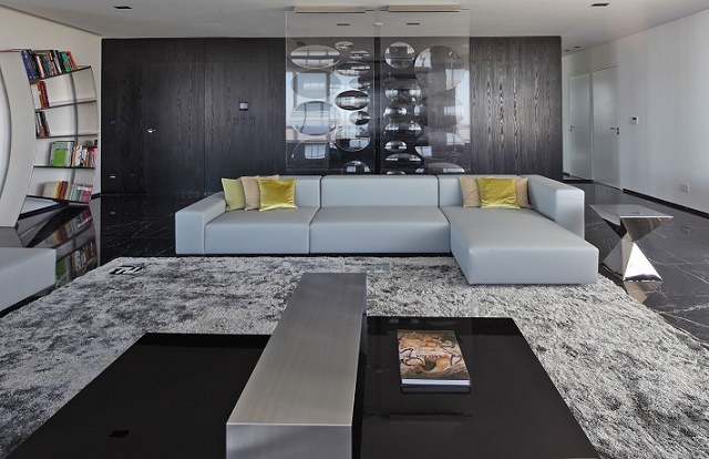black themed decoration black themed decoration Transform your house with a black themed decoration apartments grey sofa with yellow cushions on grey furry rug with black and silver table luxurious apartment interior design by vestudio arquitectura