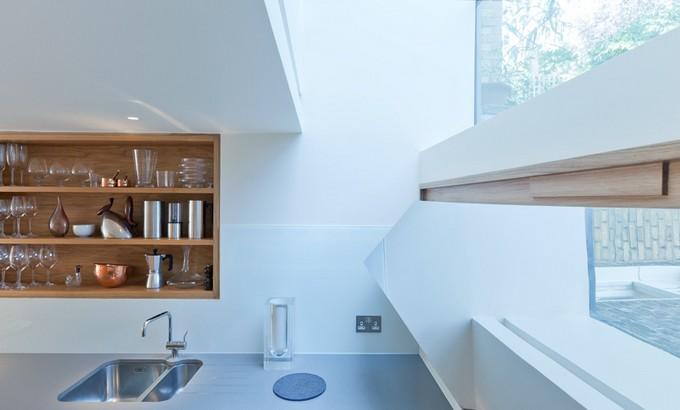 Bookshelf-staircase into London flat by Zminkowska De Boise charlie mark orlando slide 02