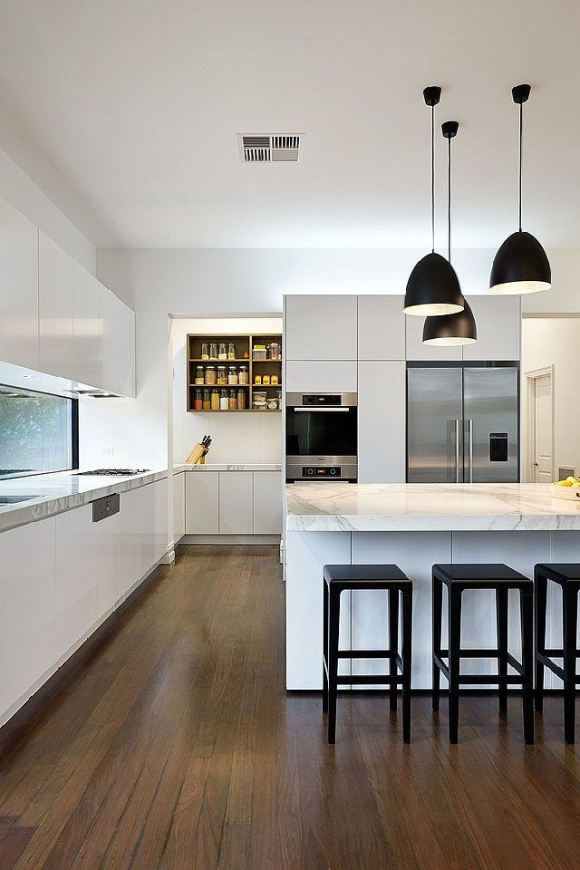white kitchen with bell shape shade in matte black made of carbon steel