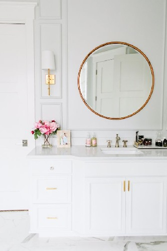 Add some brass details to your living room design round mirror