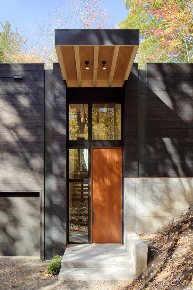 HOW STRIKING IS THIS BLACKENED WOOD CABIN